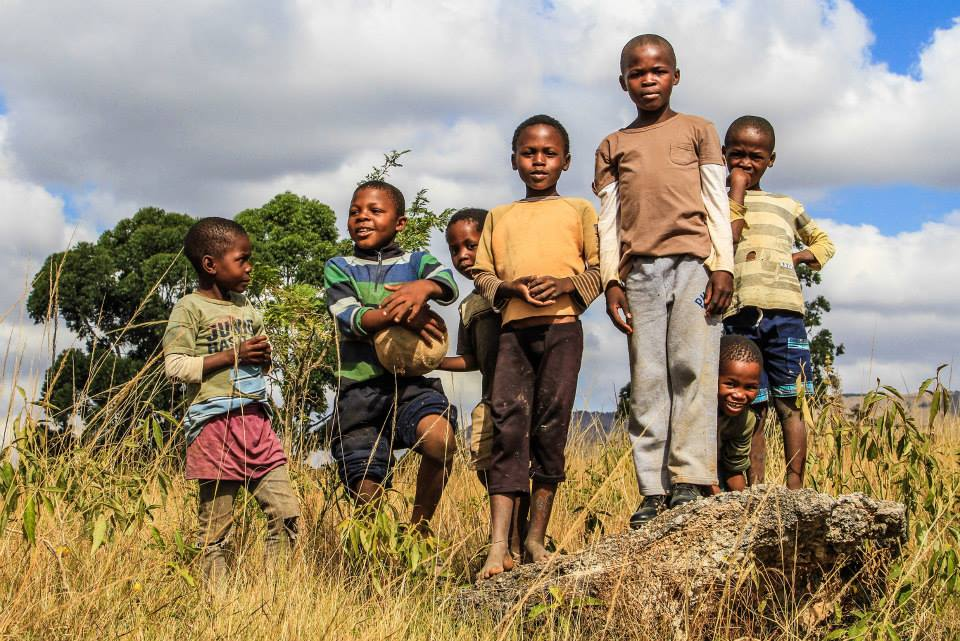 Taken around 5 miles outside of Mbabane in Swaziland I pulled over as I saw a group of kids kicking a football. My guide introduced me and the children saw me camera - and asked me to take their picture!